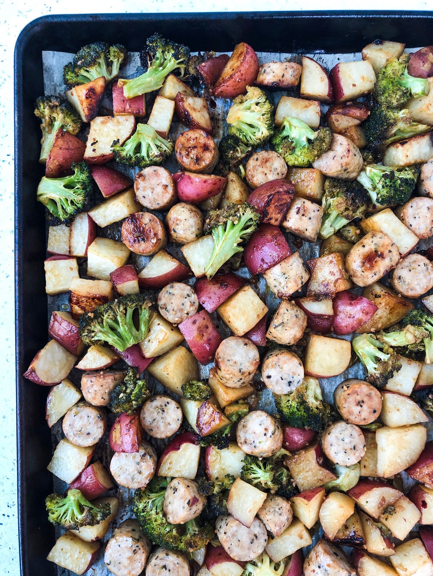 Whole30 sausage broccoli potato sheet pan dinner