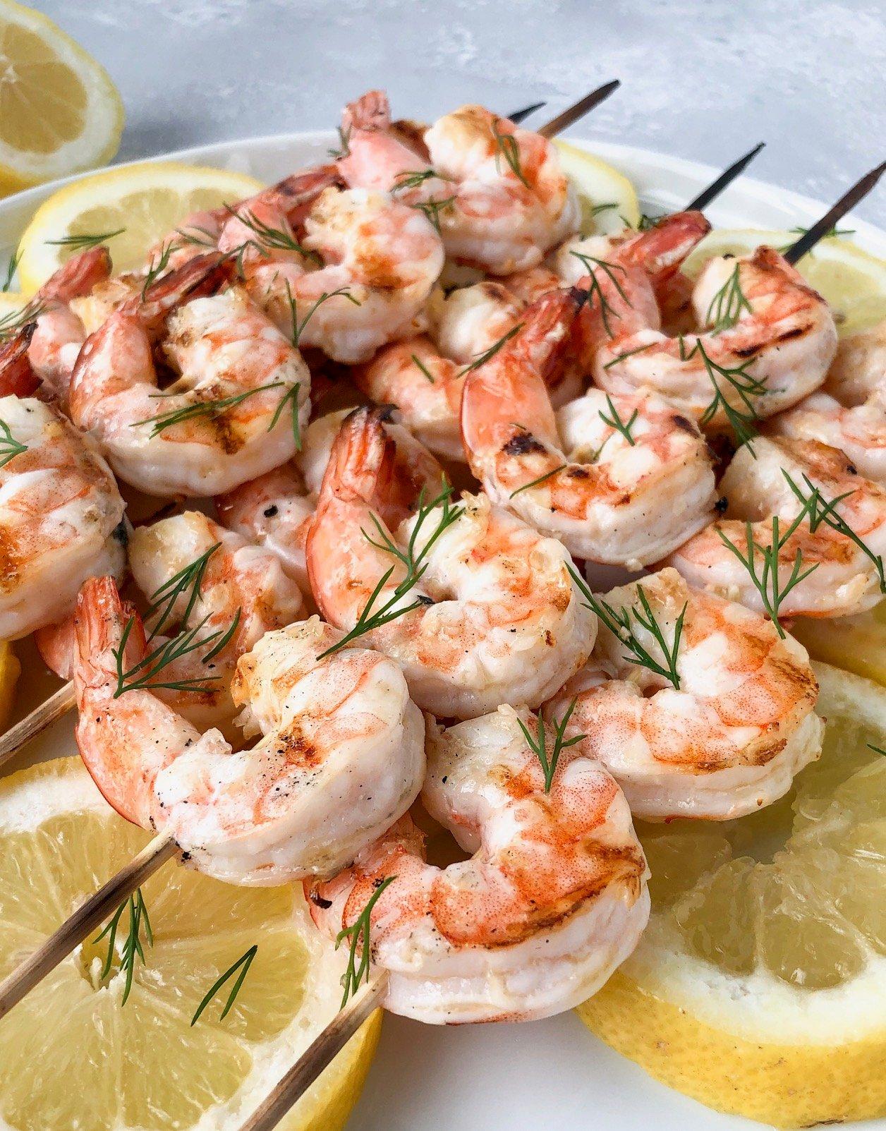 Grilled garlic butter dill shrimp over lemon