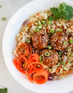 Asian pork meatball bowls with fried rice and carrot spirals