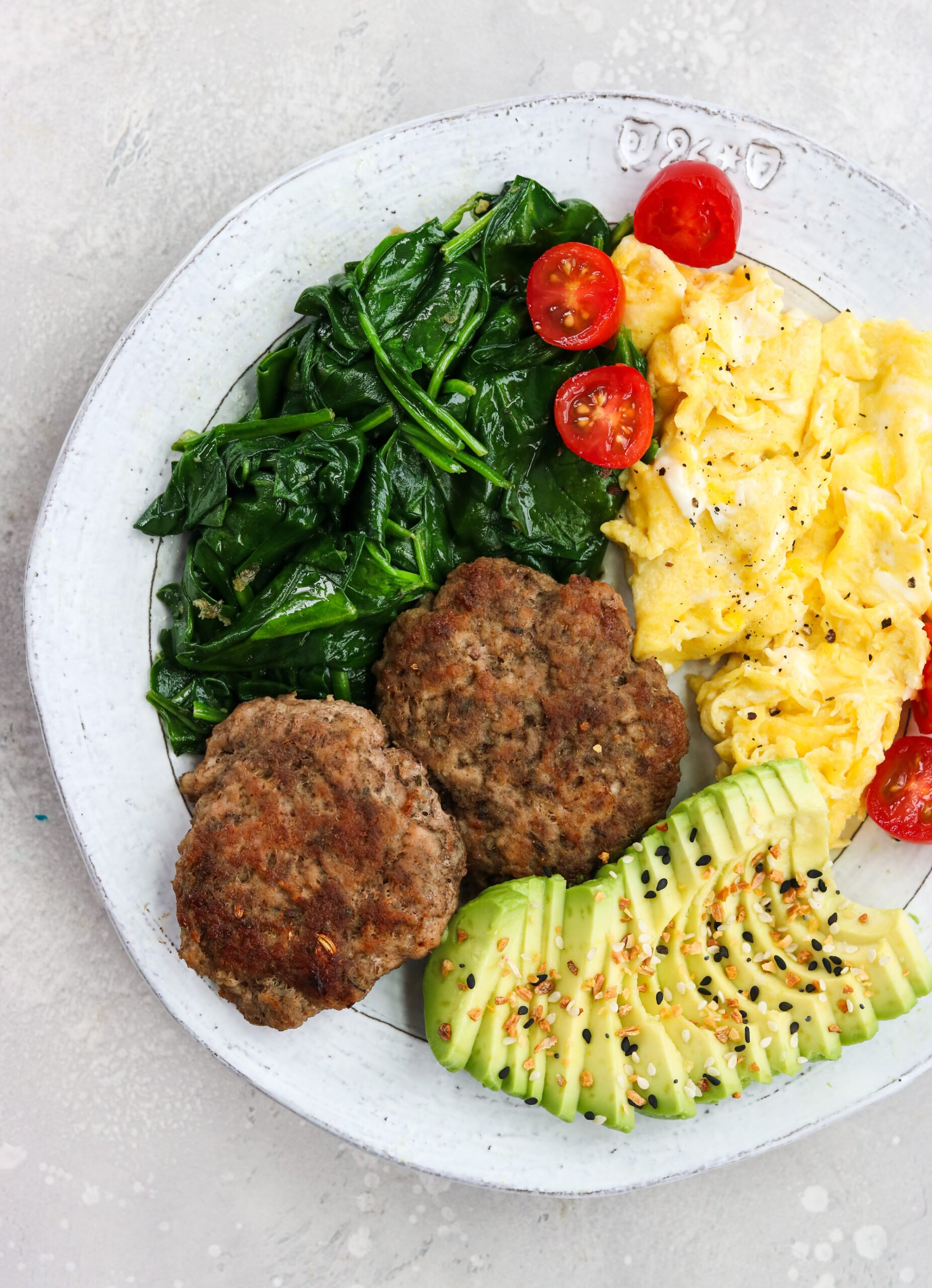 Homemade breakfast sausage with scrambled eggs and vegetables