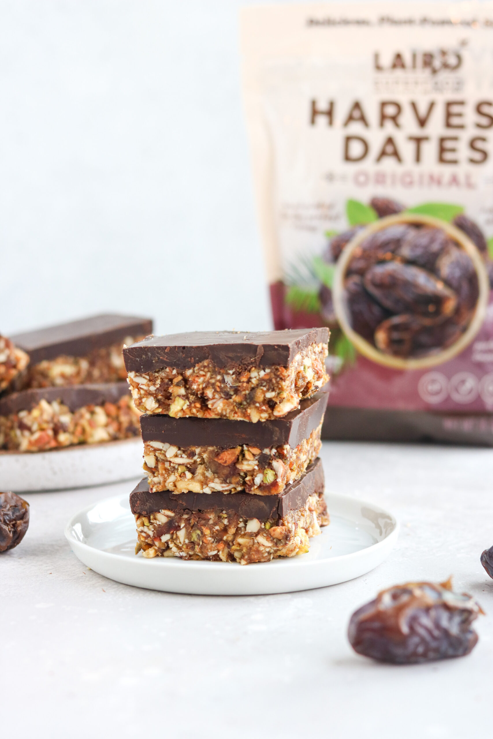 stack of fudge covered date and nut bars