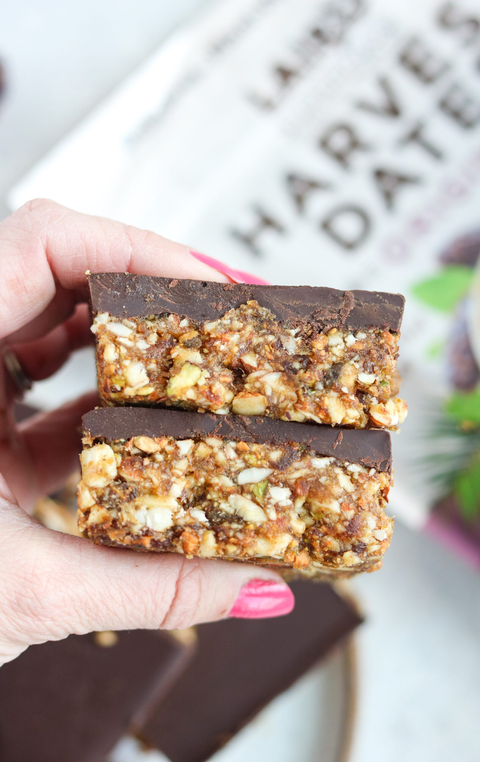woman holding chocolate date nut bars