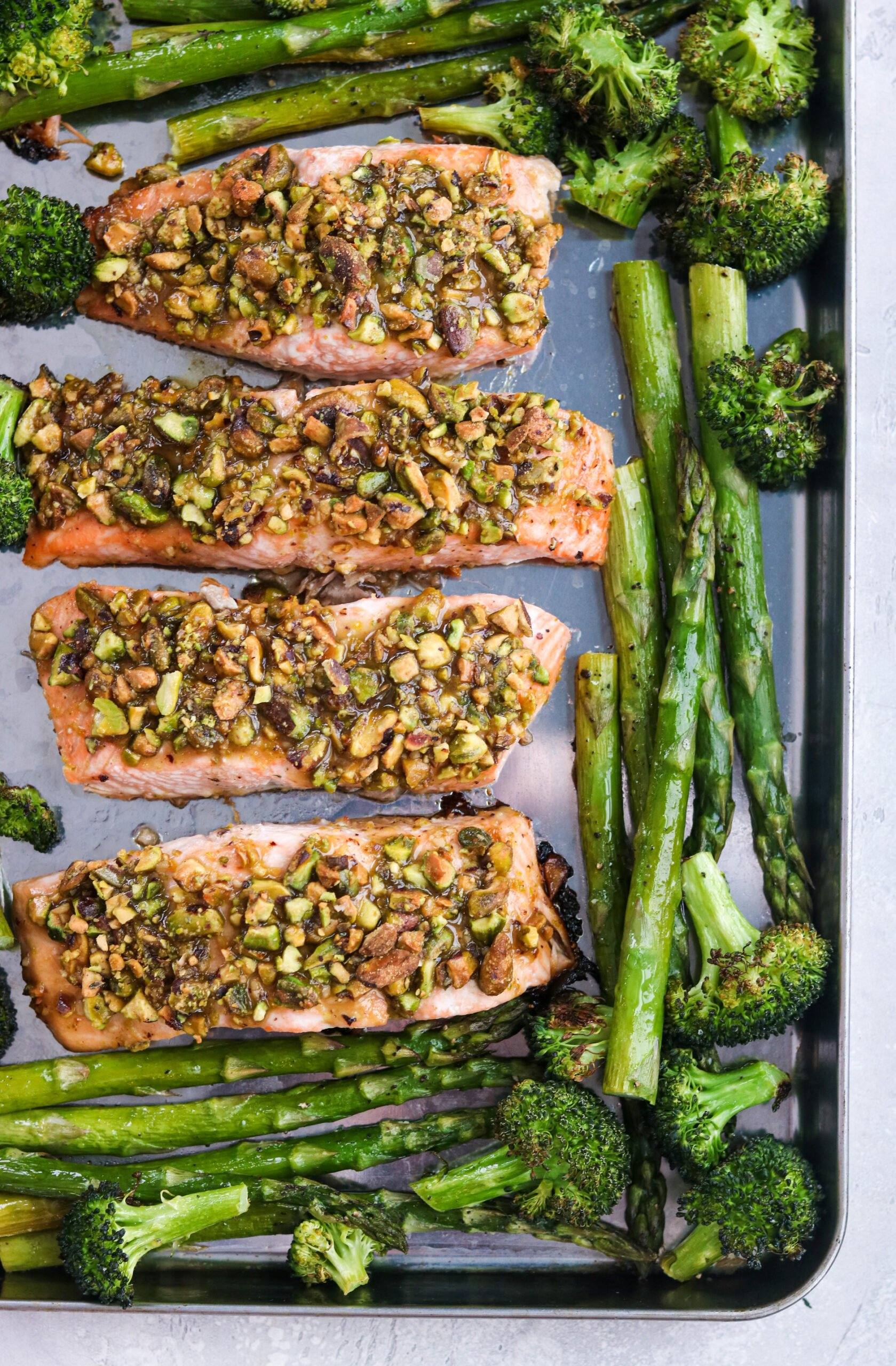 Crusted Salmon with Spring Veggies on a baking sheet