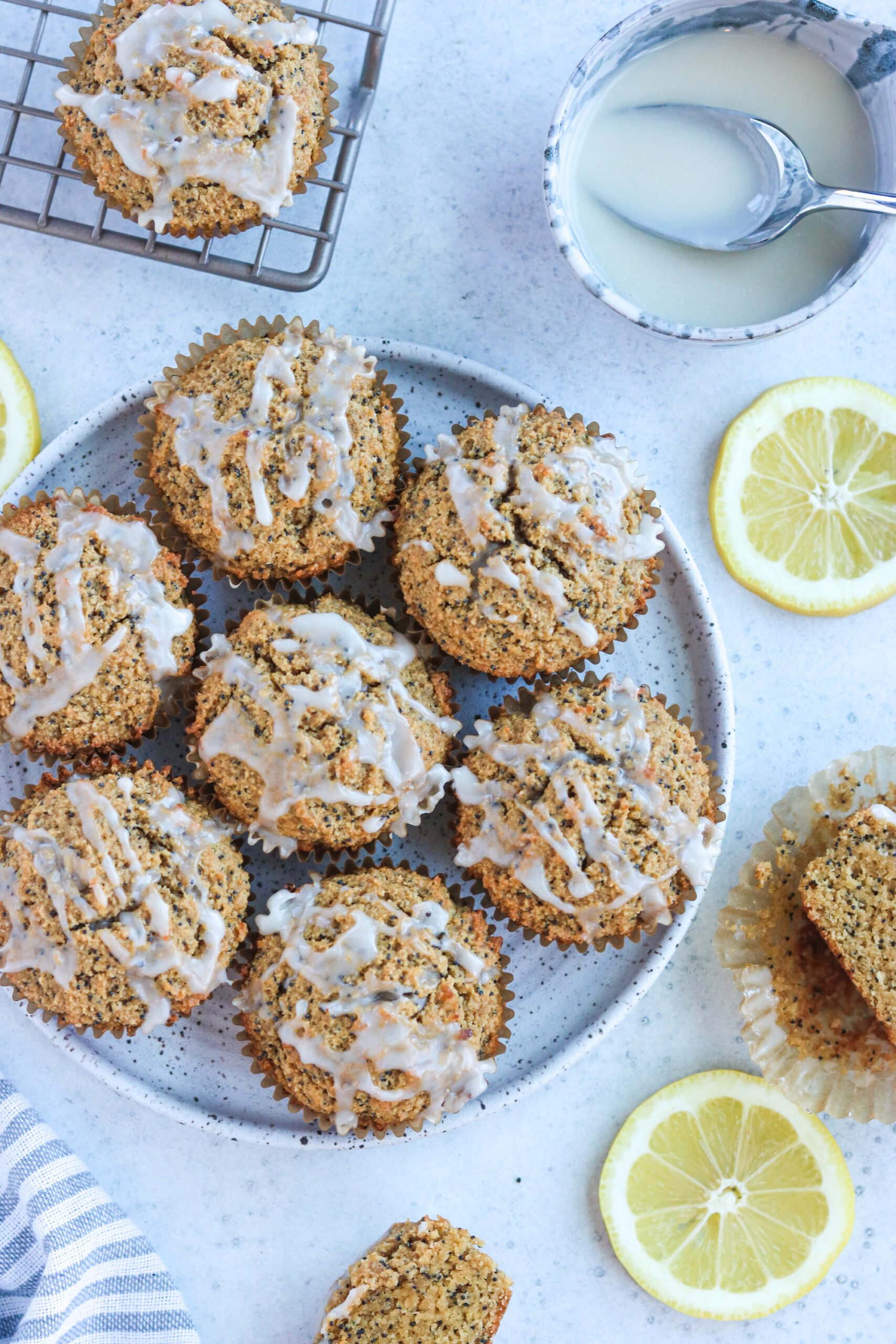 muffins on a plate with lemon surrounding it