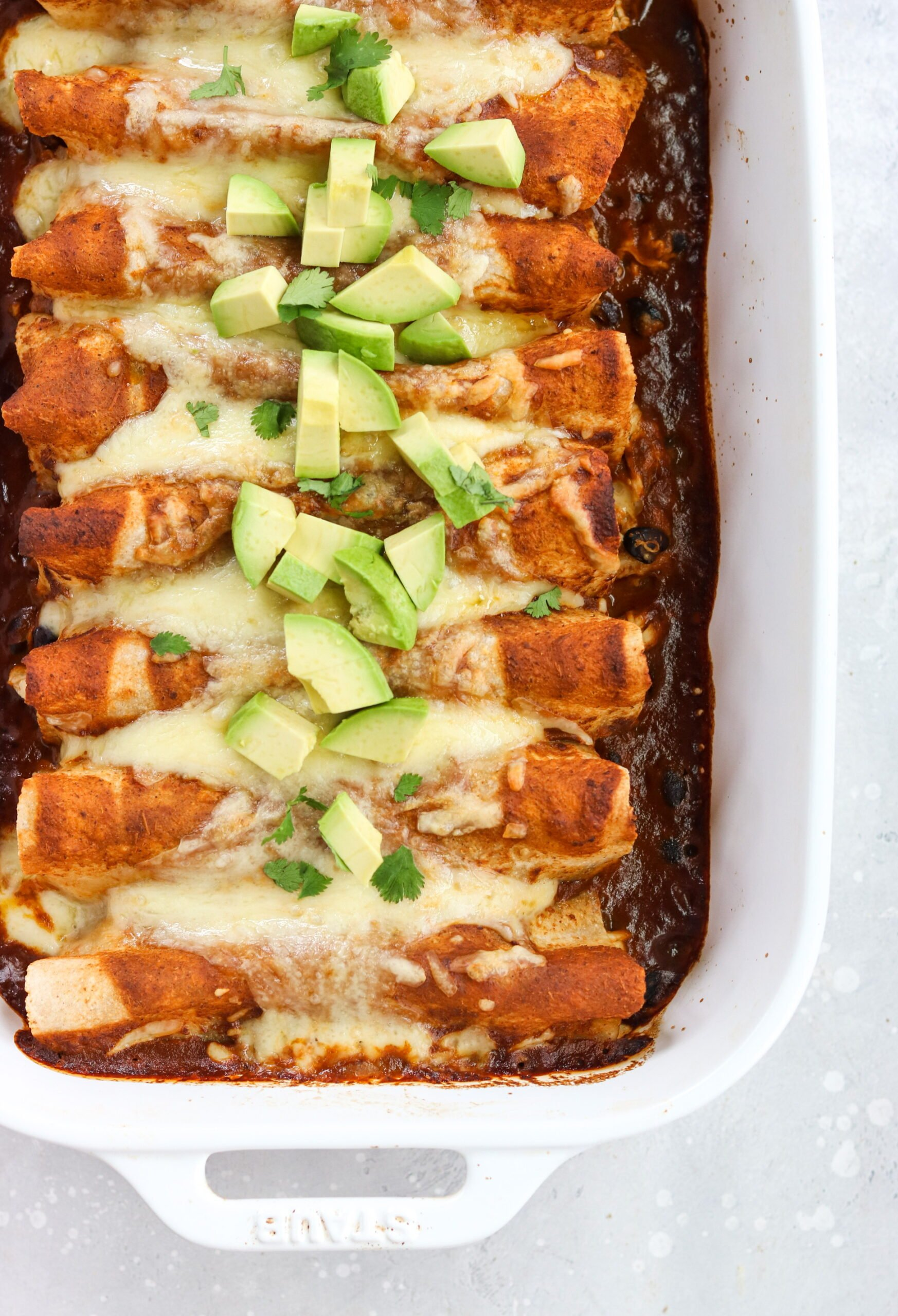grain free chicken and black bean enchiladas in a white platter