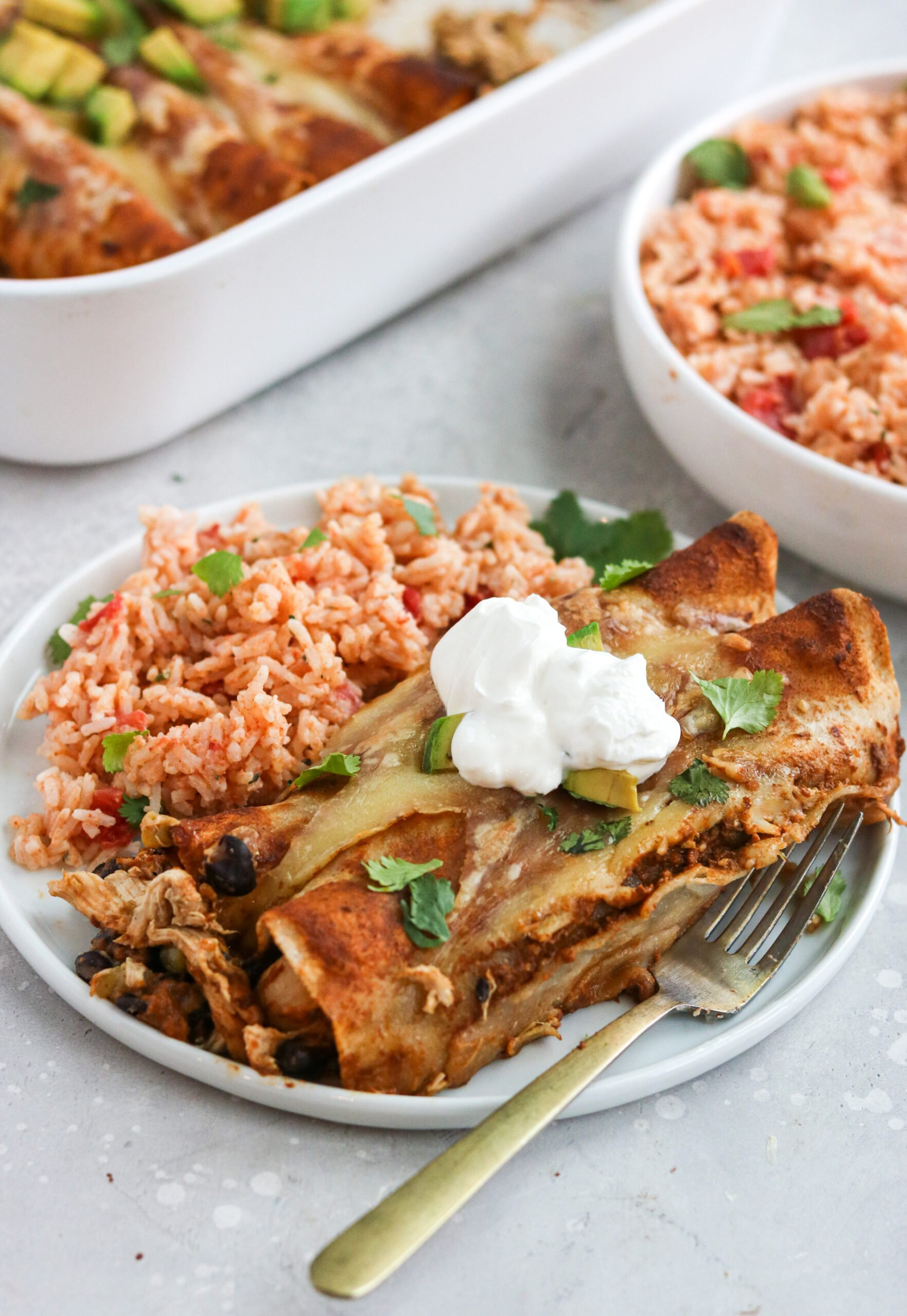 Grain free enchiladas in white plate with fork