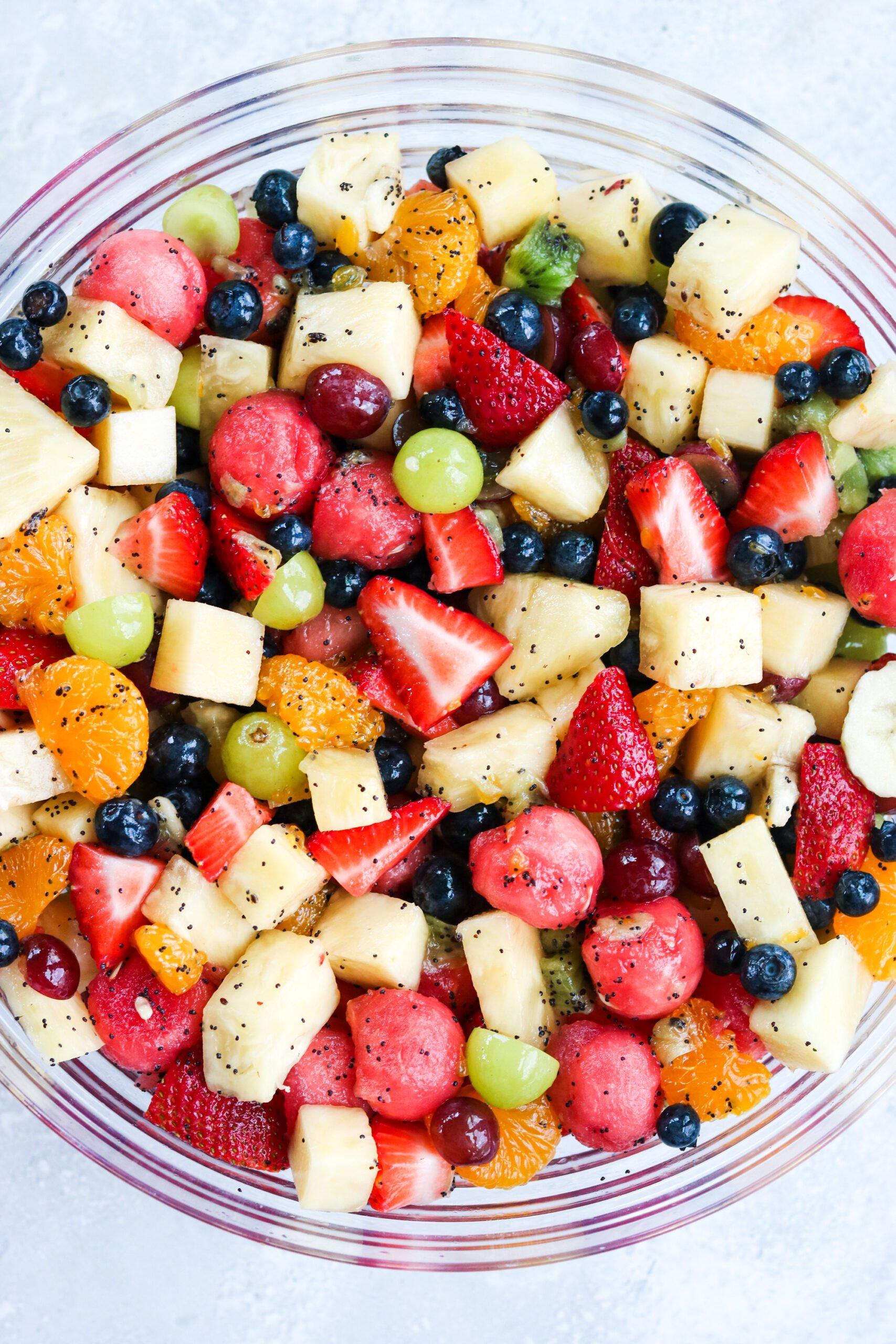 closeup image of a bowl of Honey Lime Poppyseed Fruit Salad