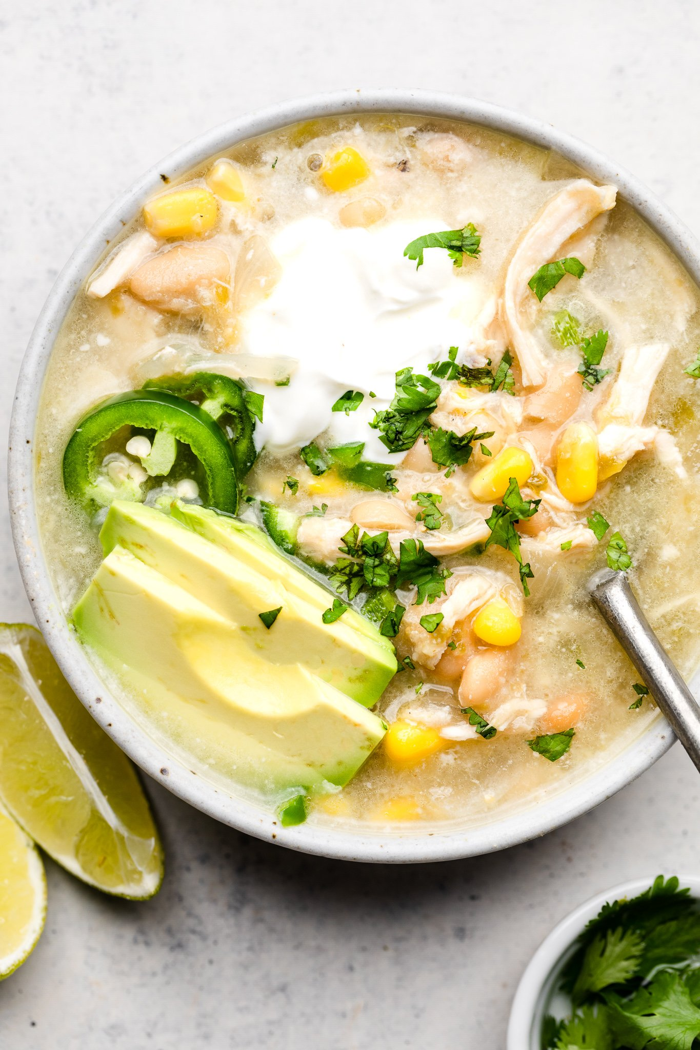 soup with corn, guacamole and garnish