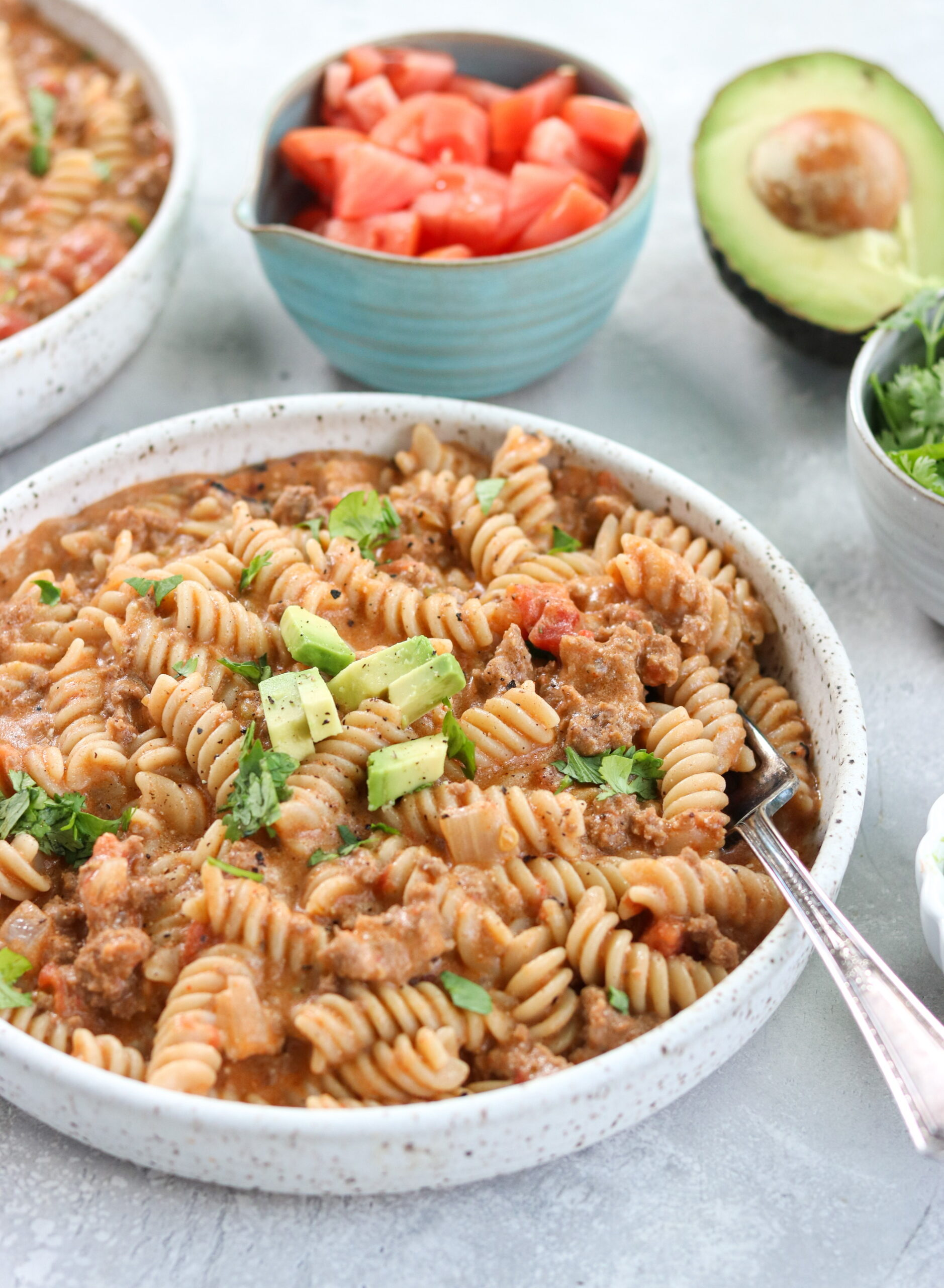 Instant Pot Taco Pasta on a white bowl with fork