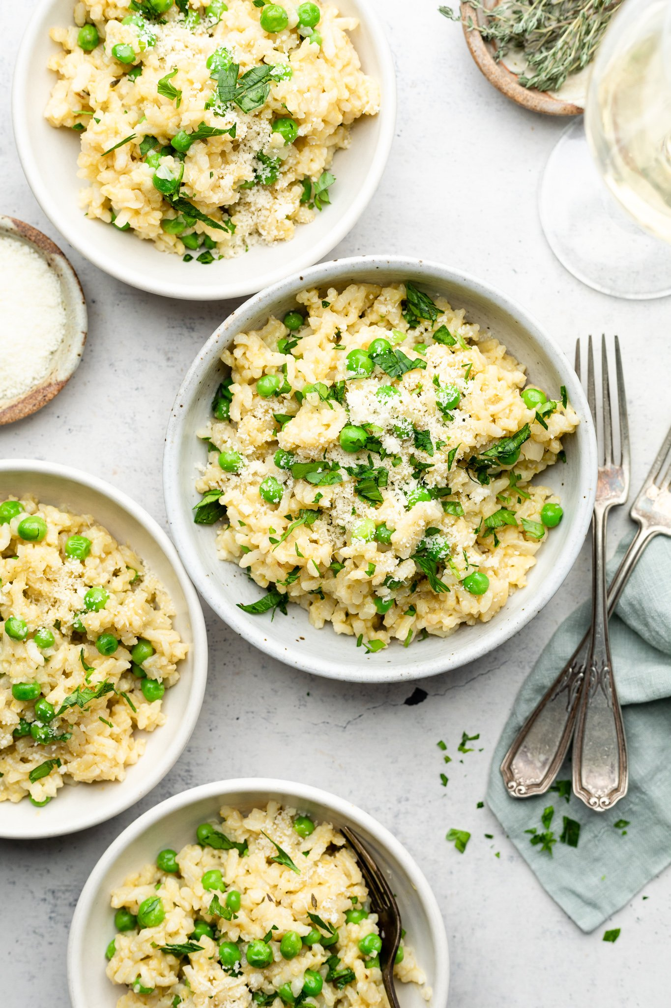 three bowls of Easy Instant Pot Risotto with Peas